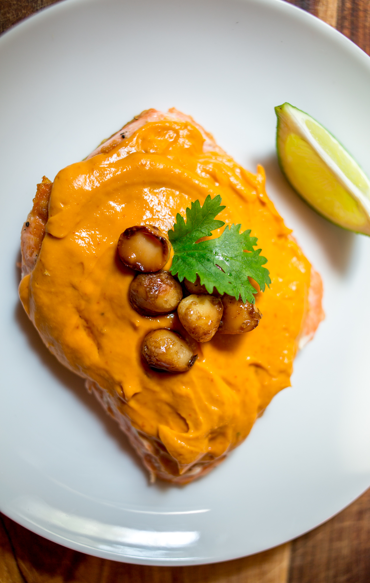 salmon with mango-chile butter and caramelized macadamia nuts